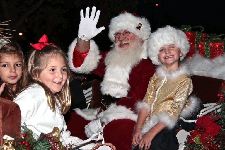 Santa and kids in sleigh